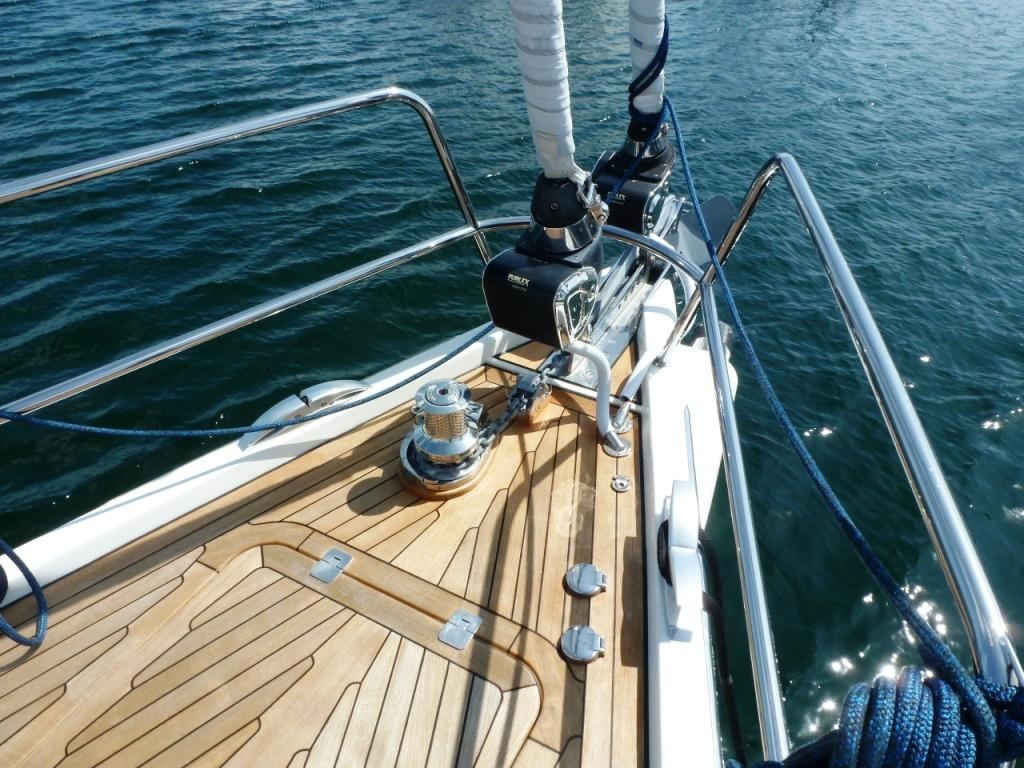 Power headsail furlers and hydraulic retractable bowsprit