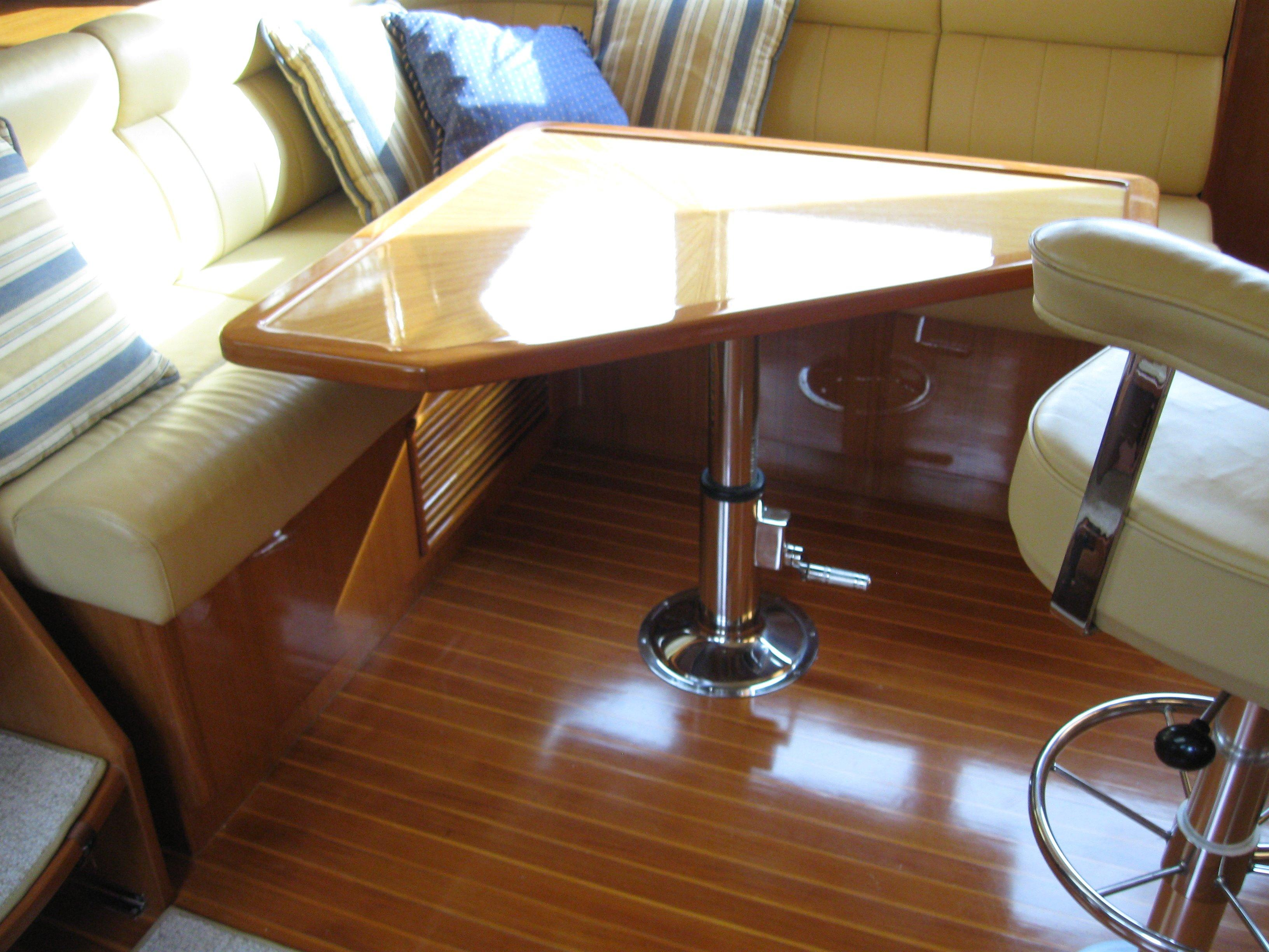 Dining table behind the captain in the pilothouse