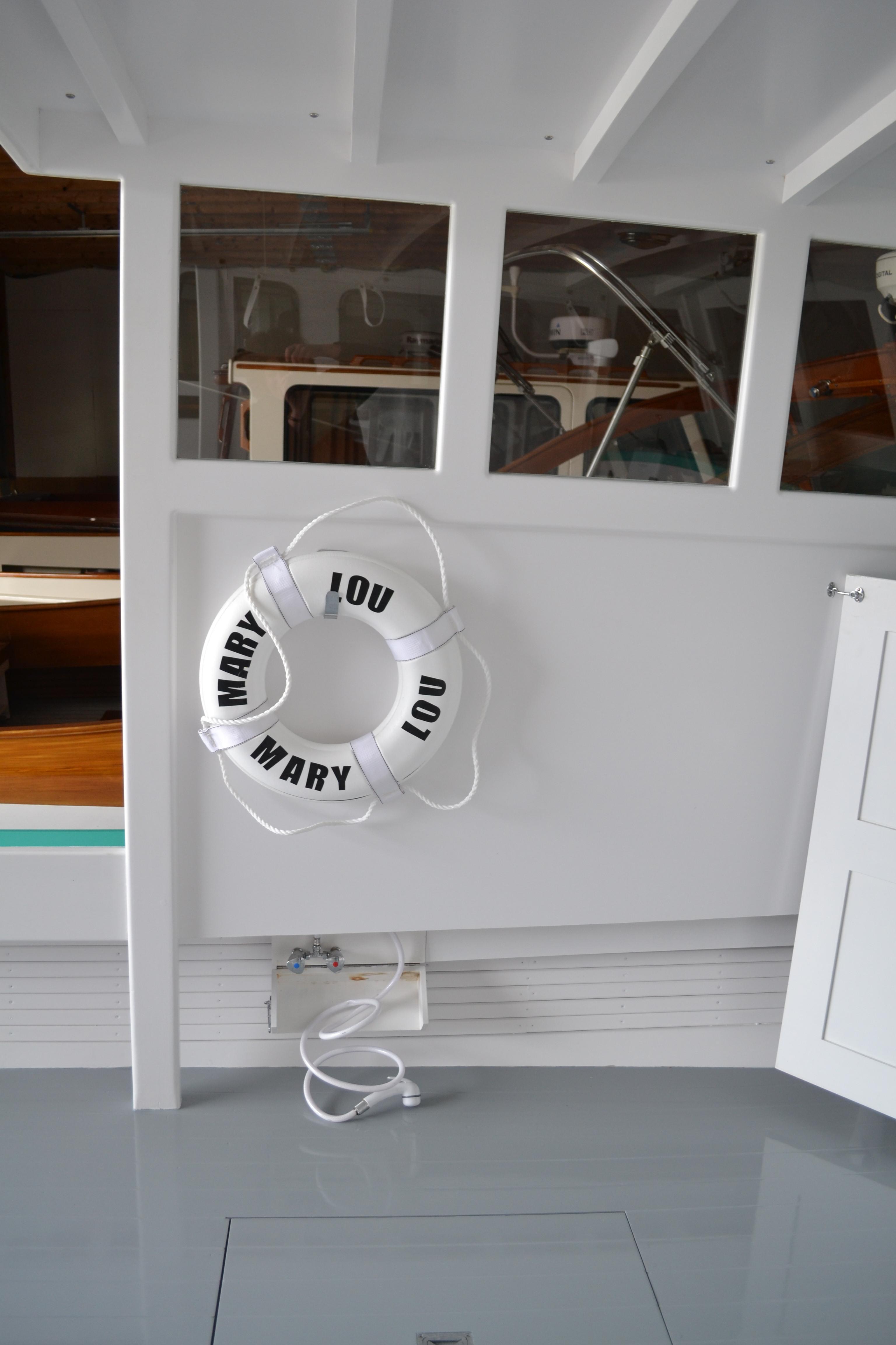 Port side with open shower locker