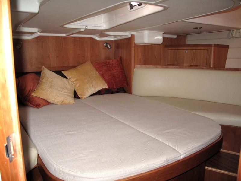 Master stateroom aft with seating on both sides