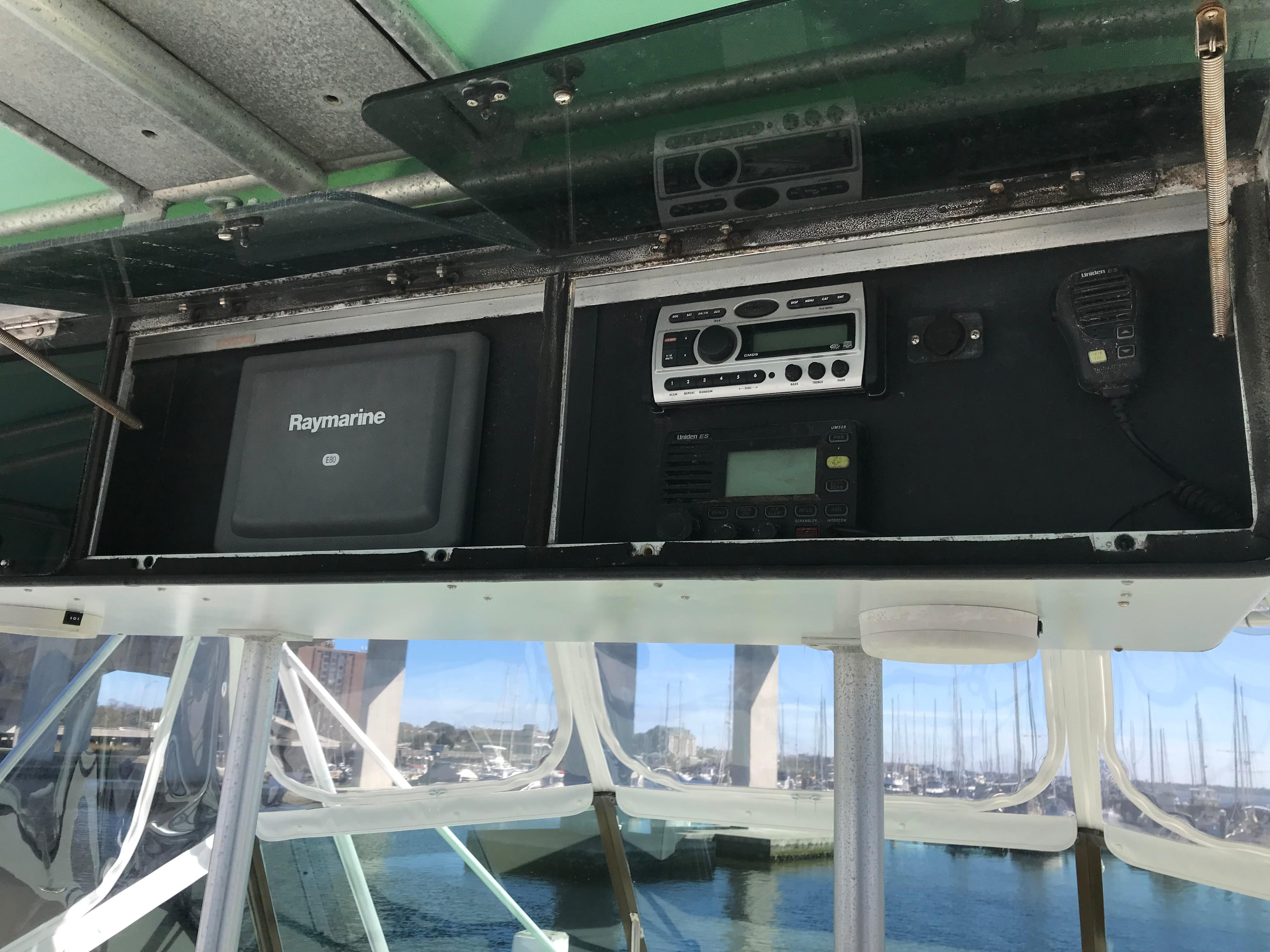 Hatteras Convertible - MUST SEE - Overhead console with second Raymarine C-80