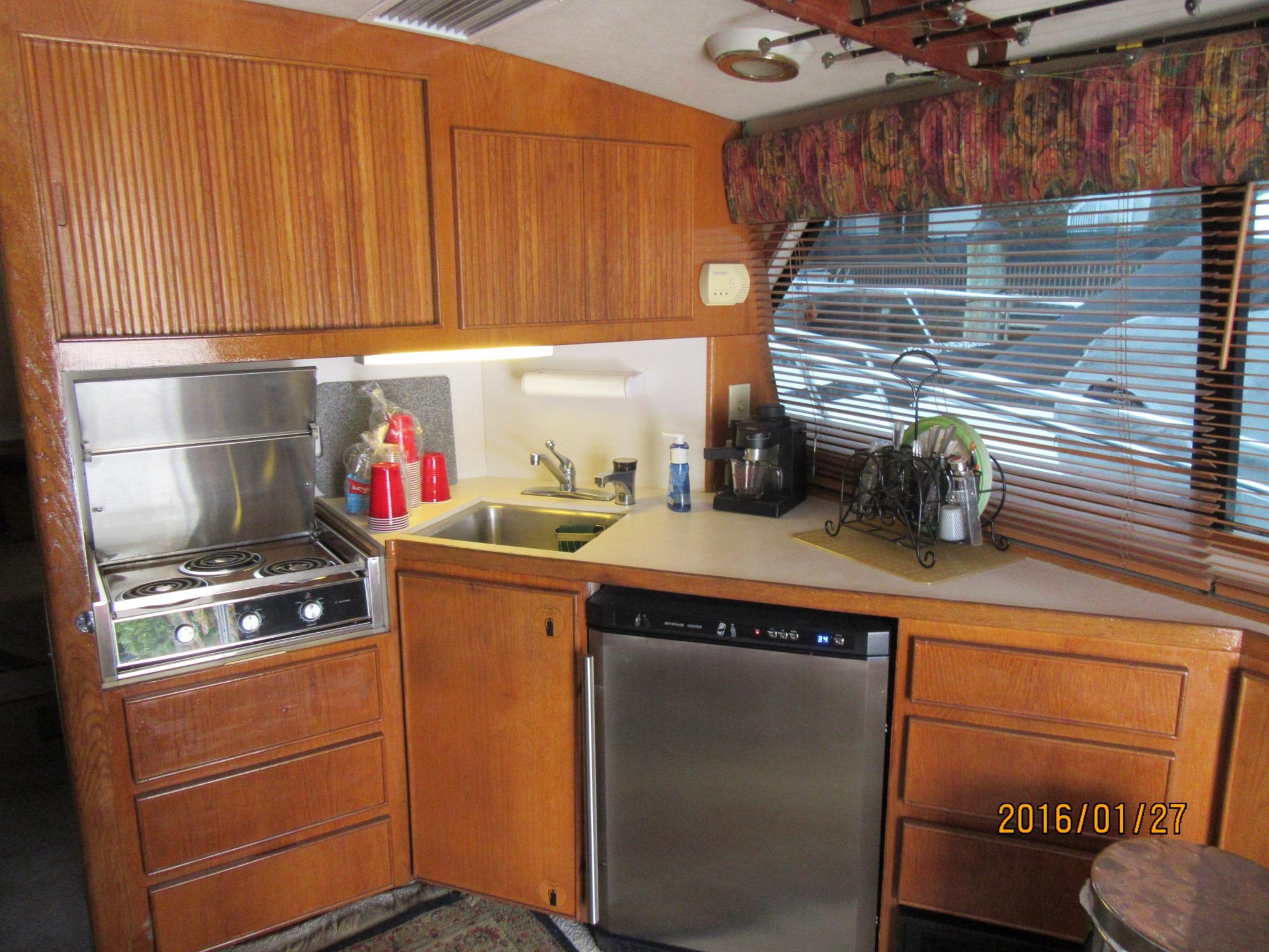 GALLEY - FUNCTIONAL LAYOUT AND AMPLE CABINETS & DRAWERS