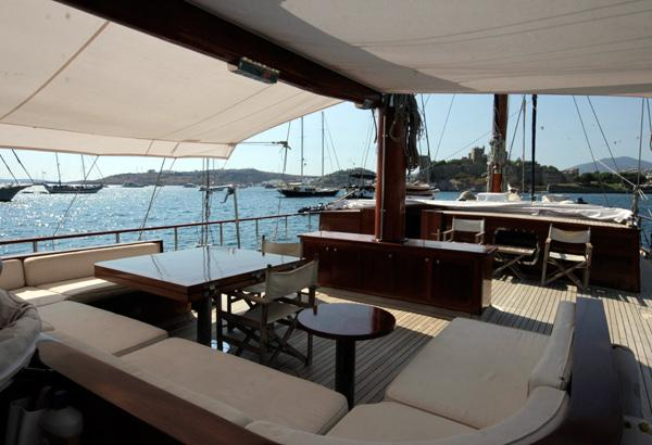 Spacious Aft Deck With Settee And Dining Table