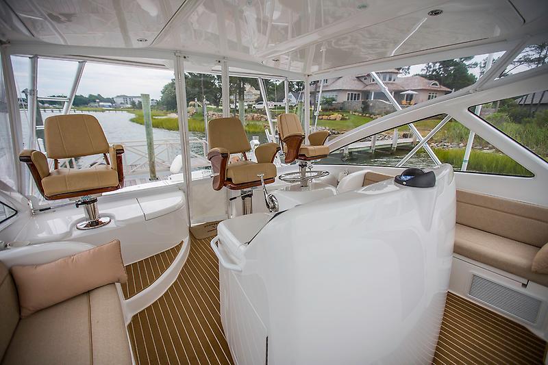 2015 Viking 42 Open, helm deck (new Costa Clear enclosure)