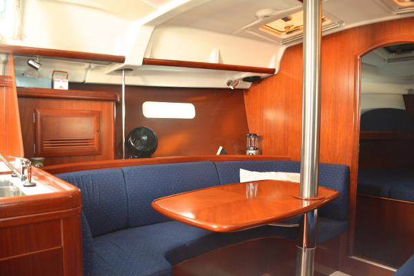 Main Salon Table That Seats 4 To 6 For Dinner, Also Drops And Makes For A Double Berth In The Main Salon