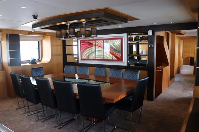 Boardroom, dining table leading to master and double bunk guest cabin