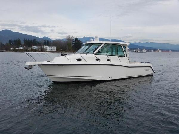 2020 Boston Whaler boat for sale, model of the boat is 345 Conquest Pilothouse & Image # 2 of 31