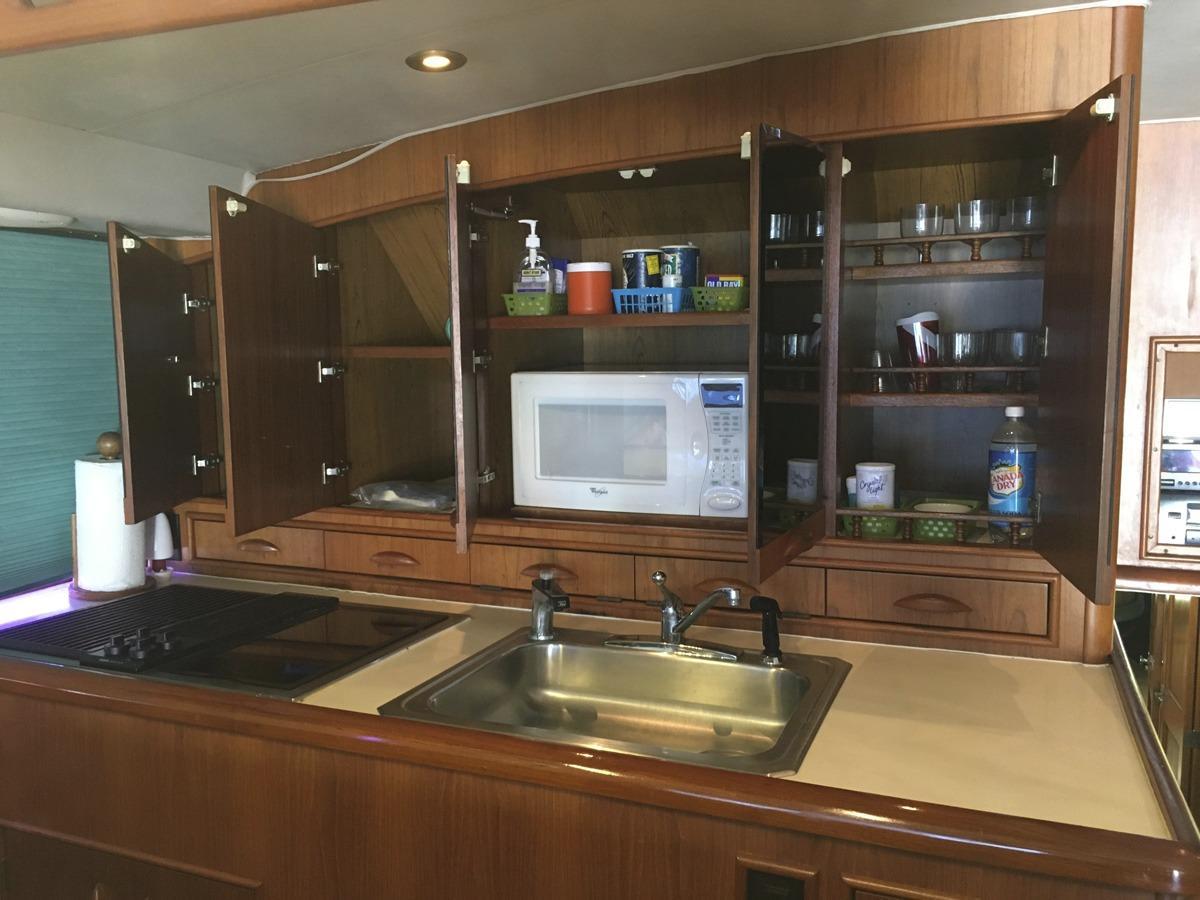 mirrored doors open above Galley sink