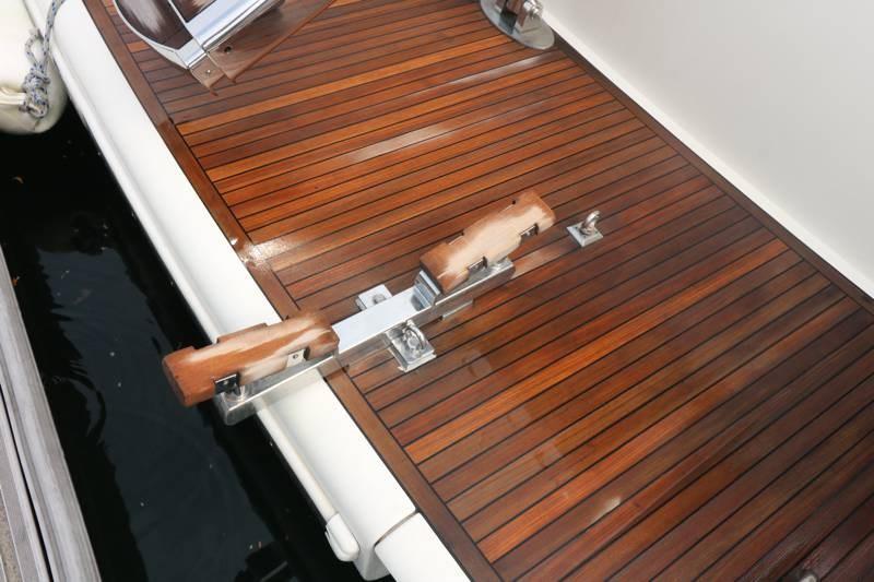 Cradle for tender on swim platform