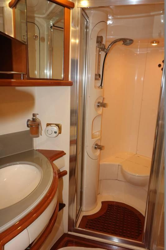 Master shower with sit down seating