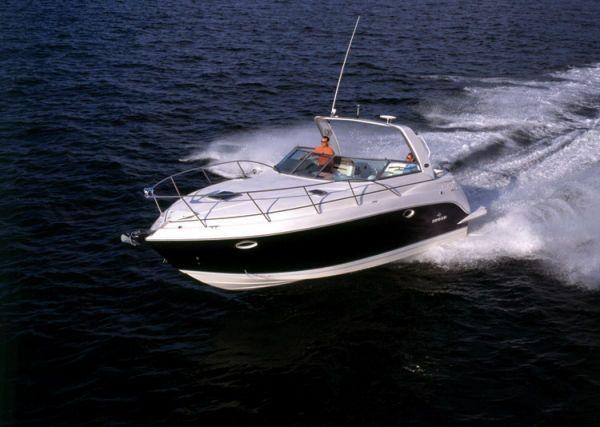 New Rinker 320 Express Cruiser. Length: 10.56 meter. Model Year: 2009