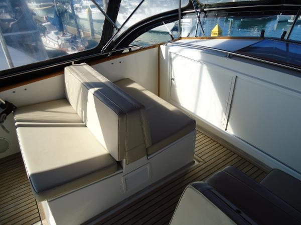 Passanger seating opposite helm