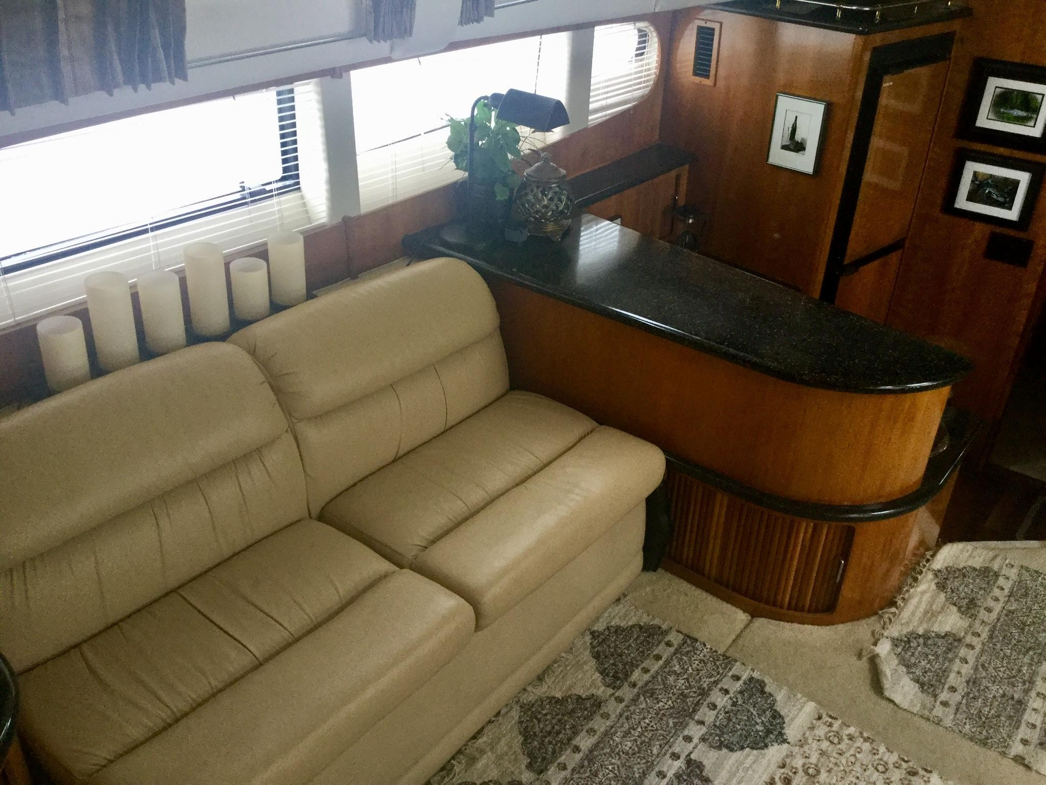 Carver 396 Aft Cabin MY - Salon Love seat to port side and galley