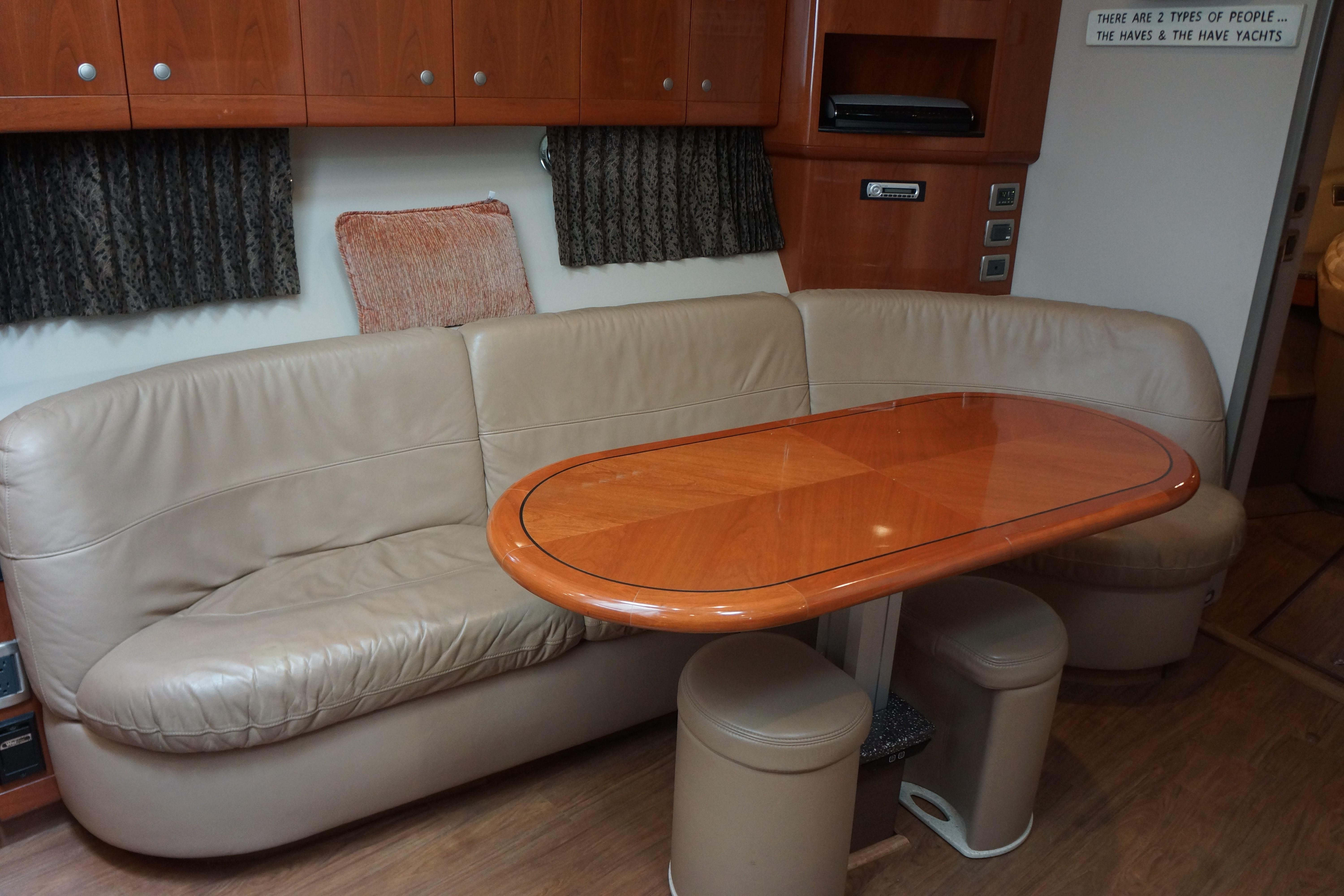 Formula 48 Yacht - Cresent shaped lounge with electric hi/lo table