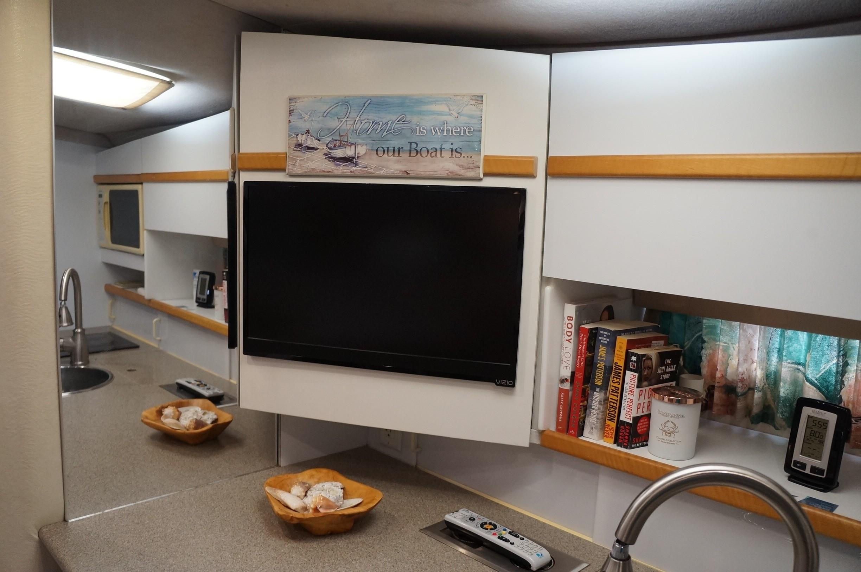 Upper galley storage/ Flat screen TV