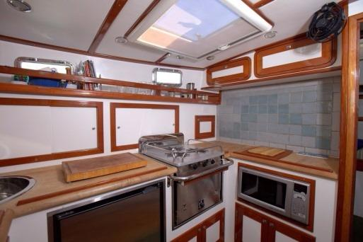 Galley with custom tile and butter block