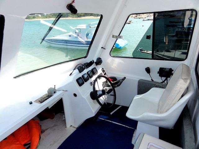 46ft Flybridge Cruiser Enclosed Flybridge Helm