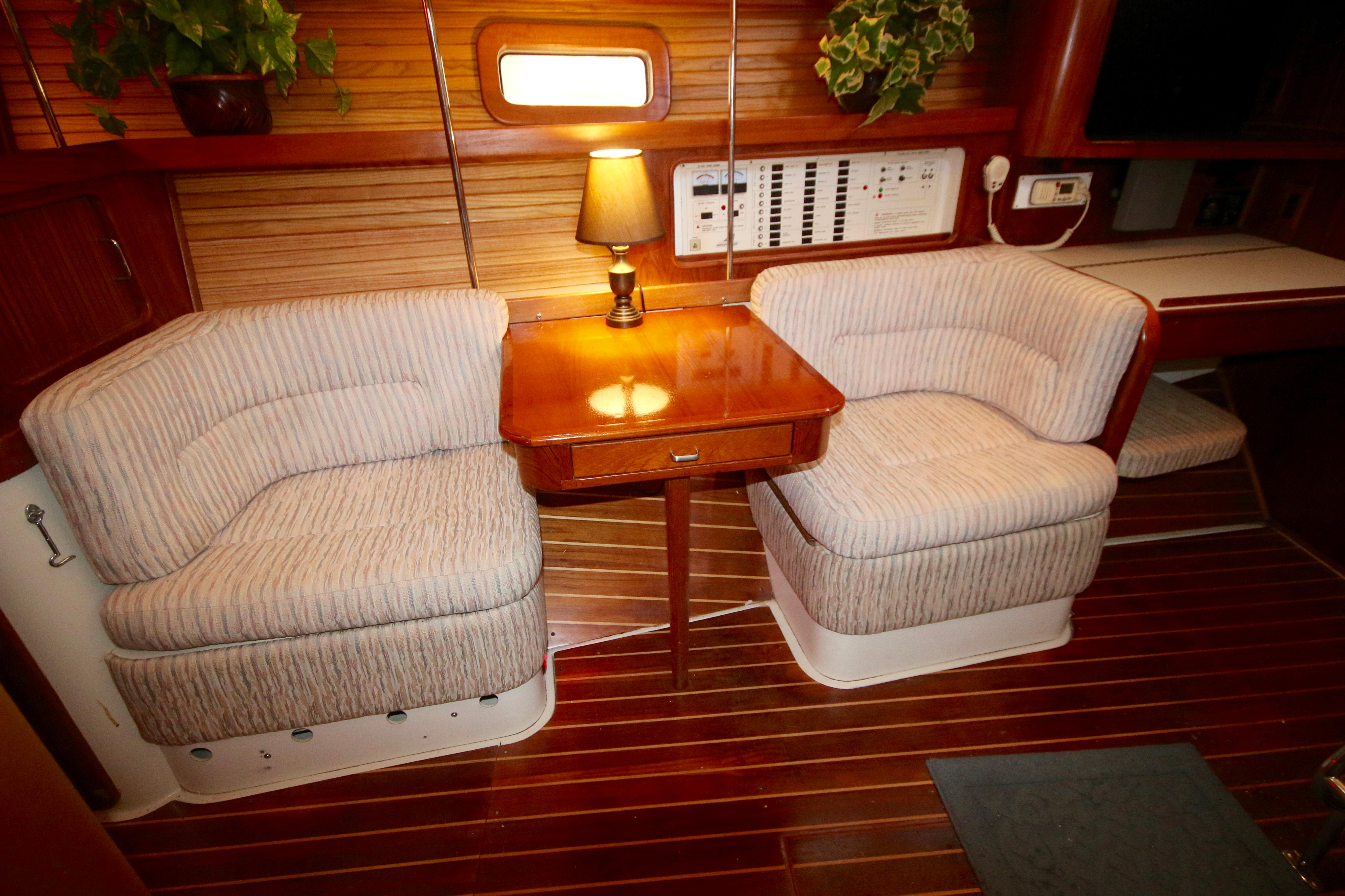 The Settee Converts Into Seats With A Table In The Middle