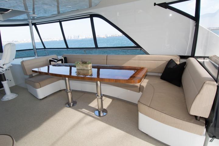 Flybridge lounge w/ custom 1 piece wood table