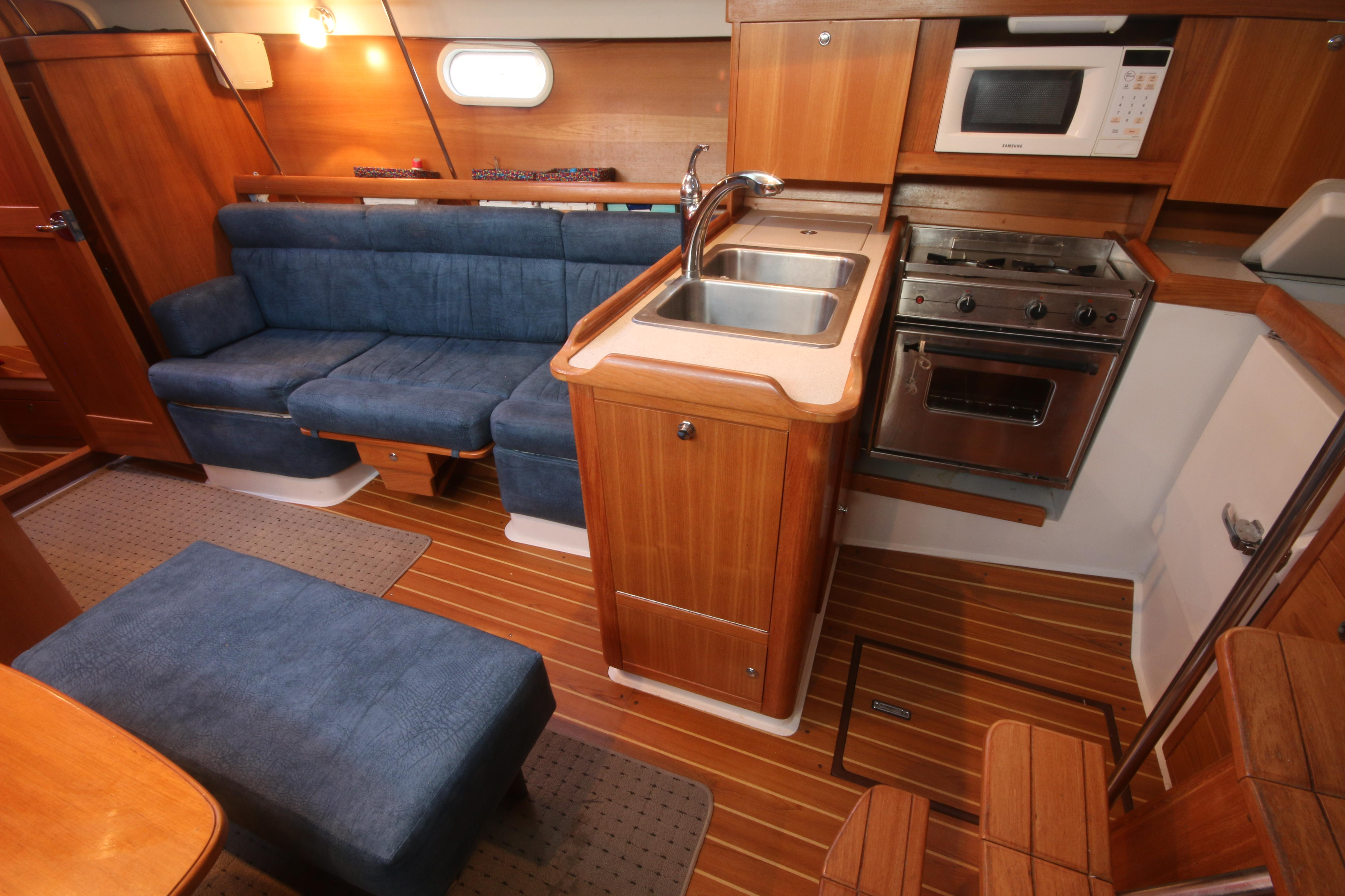 The Settee To Port Can Be Converted Into A Double Berth, And There Is Also A Larger Table That Mounts In Place Of The Drinks Table.