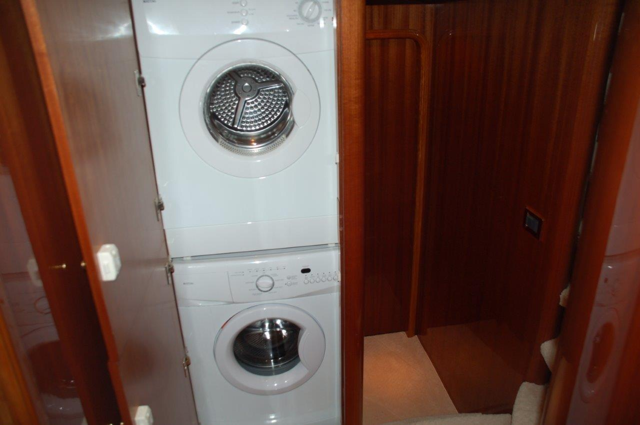Forward laundry in cabinet