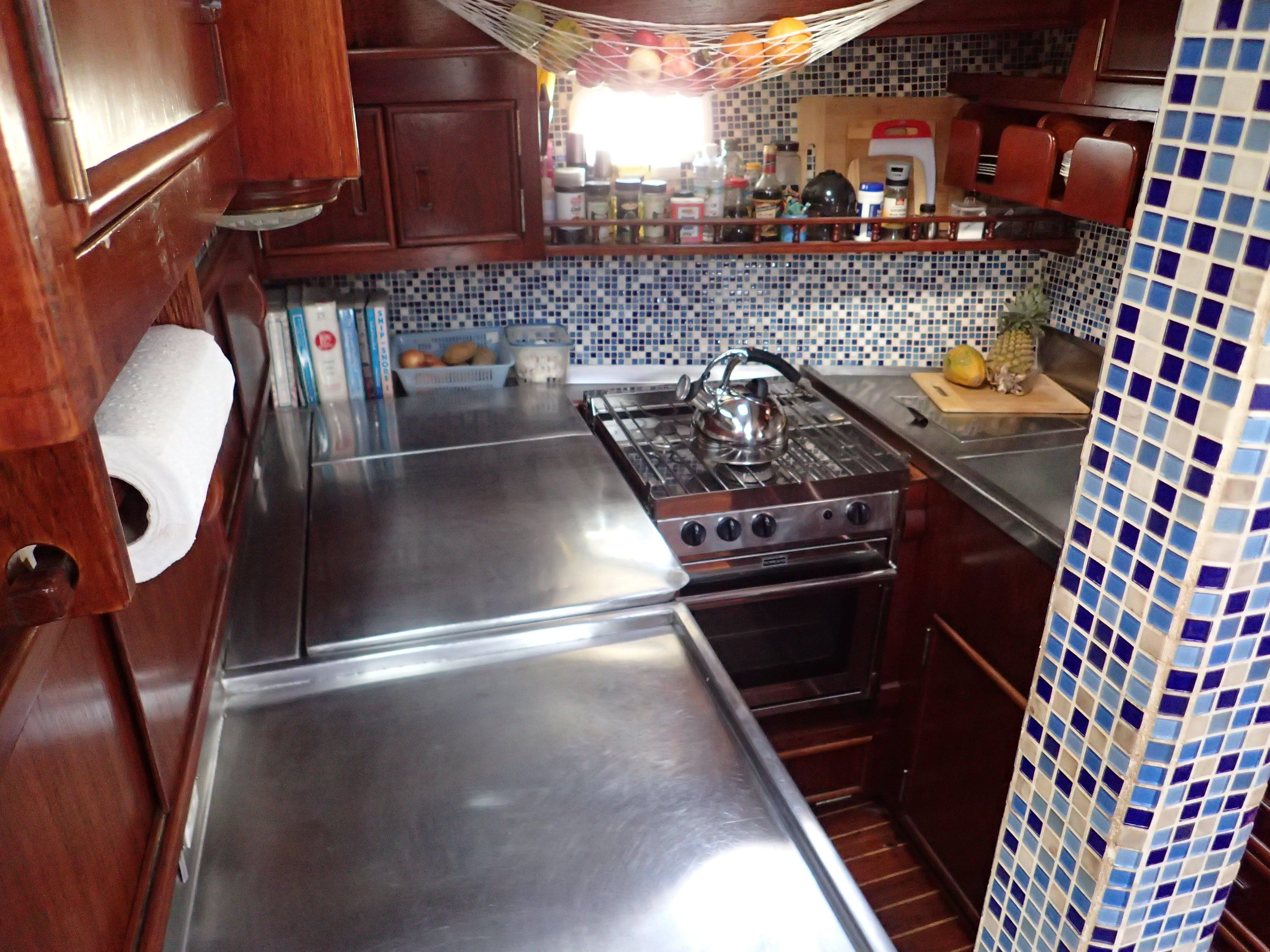 Galley Has Custom Stainless Steel Counters, Italian Tile, And Lots Of Storage