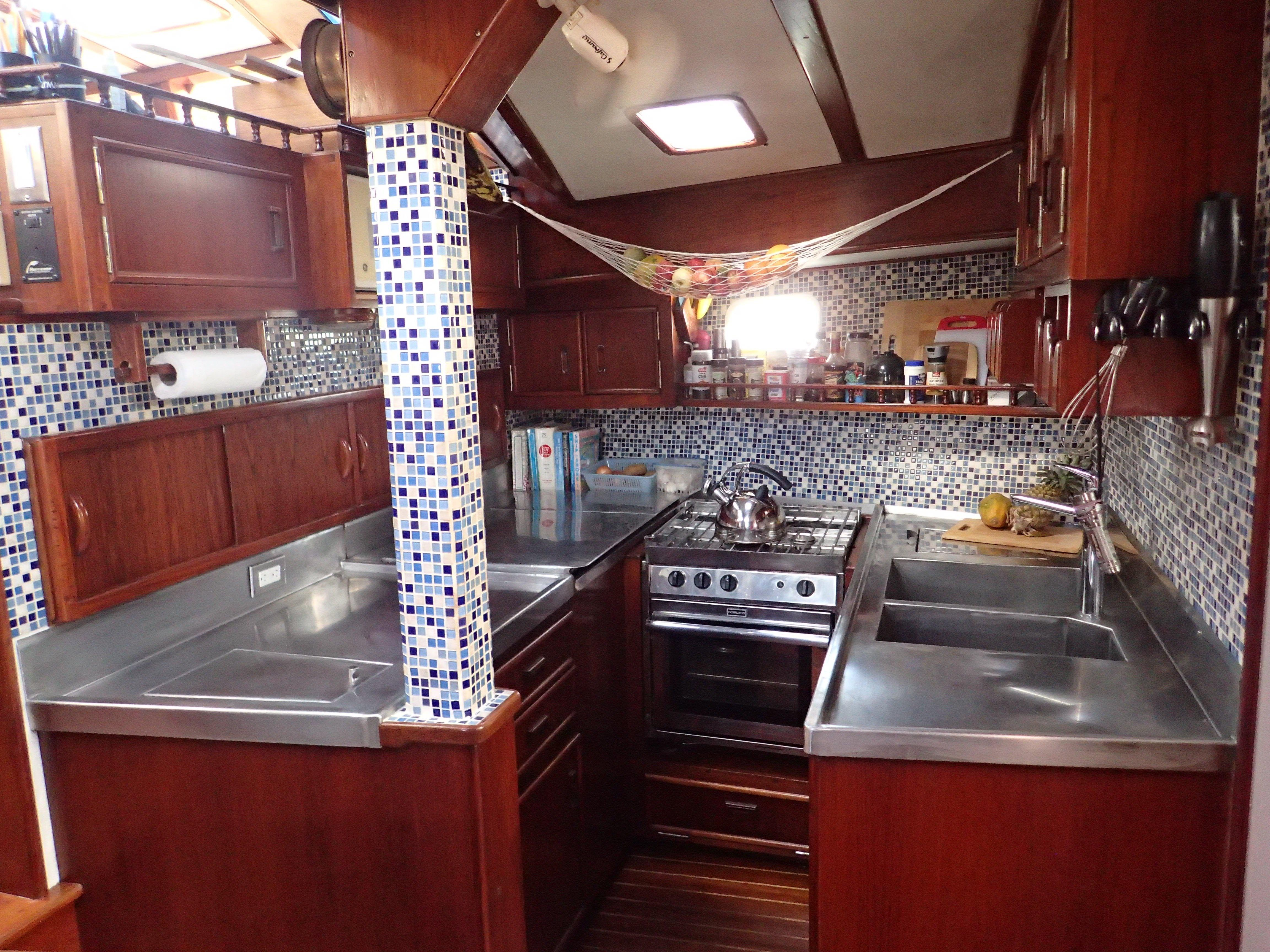 Stainless Steel Double Sinks And Italian Tile For Full Galley Refit In 2015