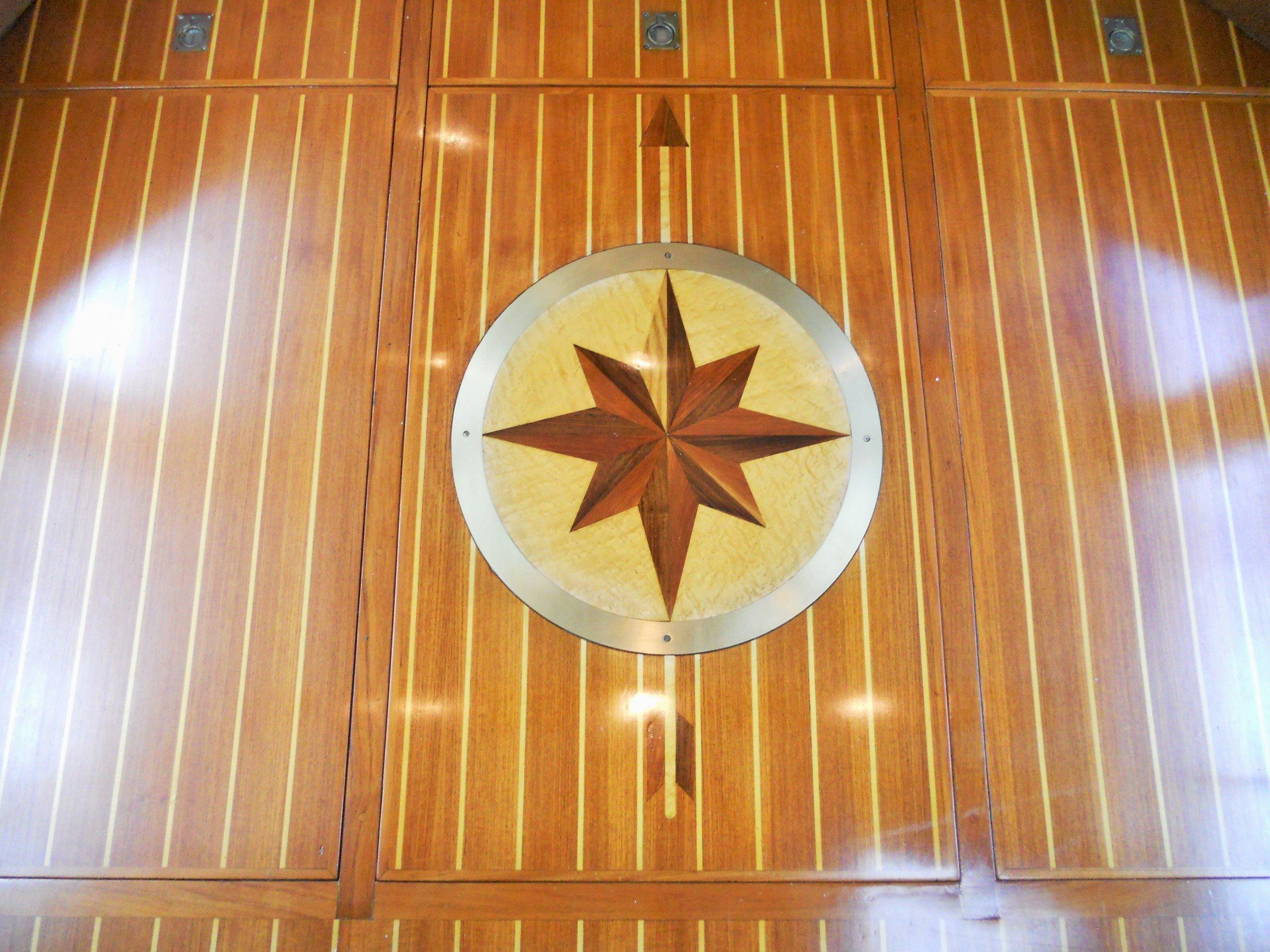 Compass inlayed teak & holly flooring