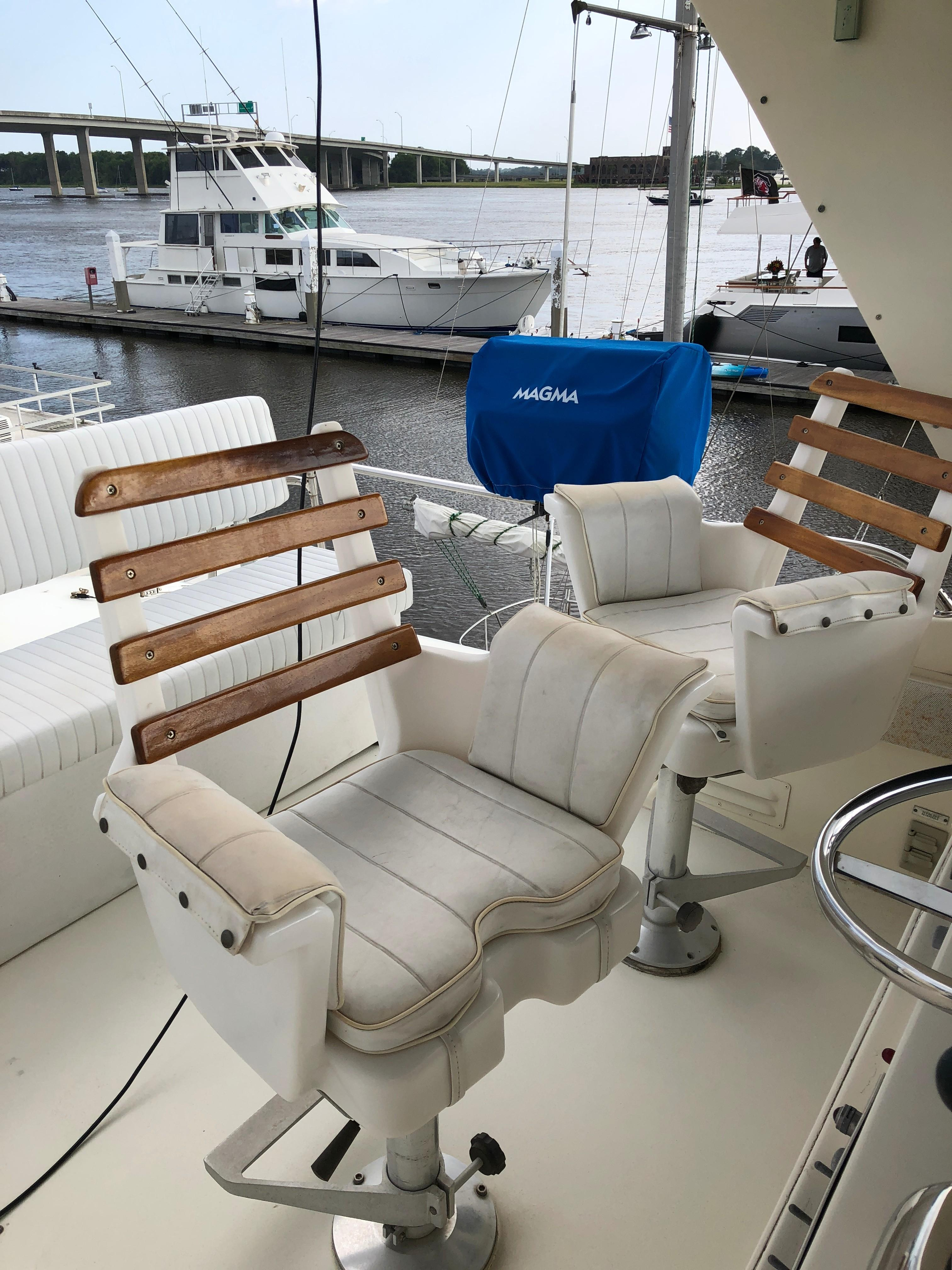 Hatteras 53 Motor Yacht - Flybridge helm seat and companion seat