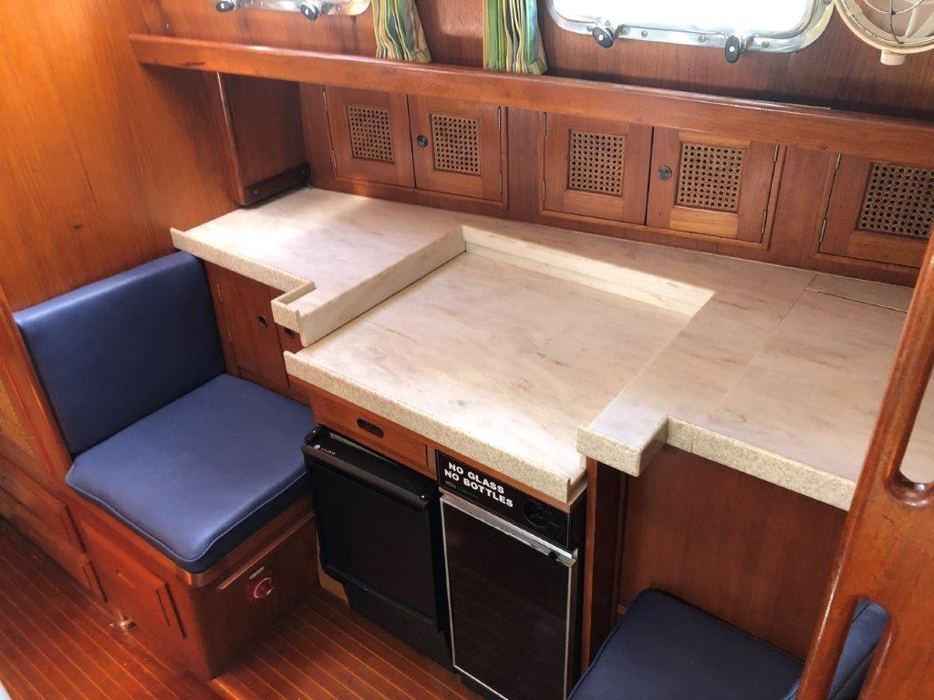 Galley seating with pull-out table