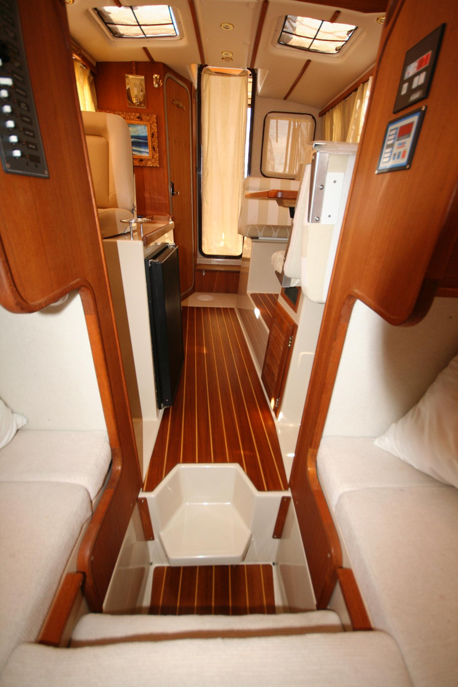 Main Salon Area With Dinette To Port And Galley To Starboard