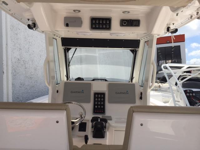 Fiberglass Hardtop With Standard Safety Storage, Four JL Audio Speakers, Rigid LED Aft Spreader Lights, Four Rod Holders And Two Kingfish Rod Holders