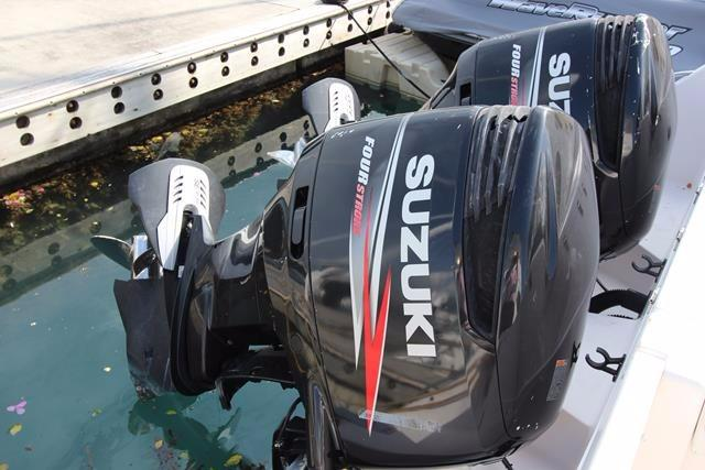 Twin outboard Suzuki 300HP with trim tabs