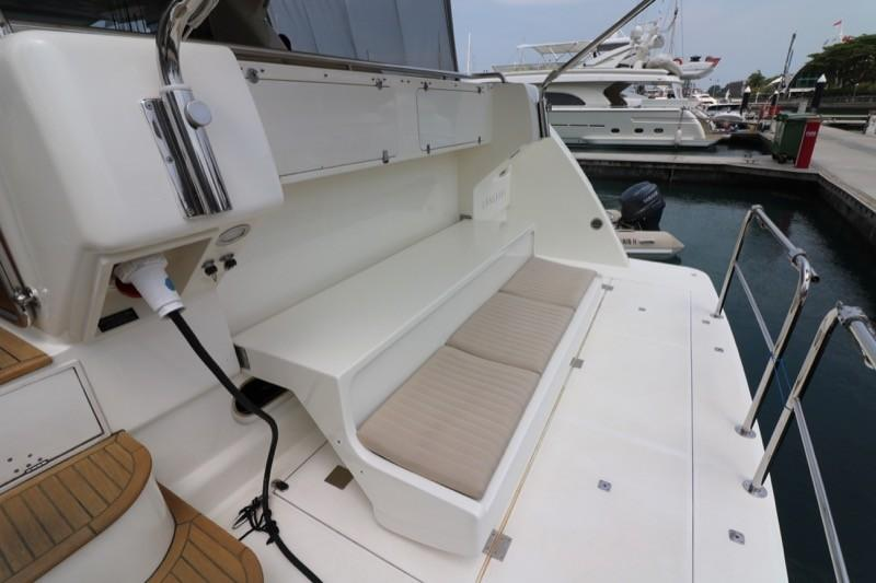 Aft bench seat folds down