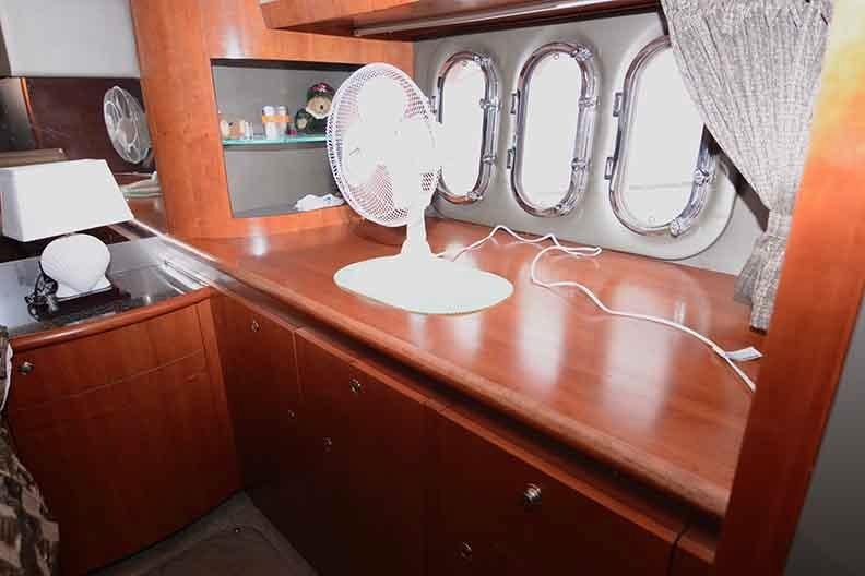 Cruisers Yachts 500 Express - Master Stateroom port windows open