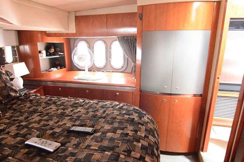 Cruisers Yachts 500 Express - Master Stateroom to Port-Washer Dryer Cabinet
