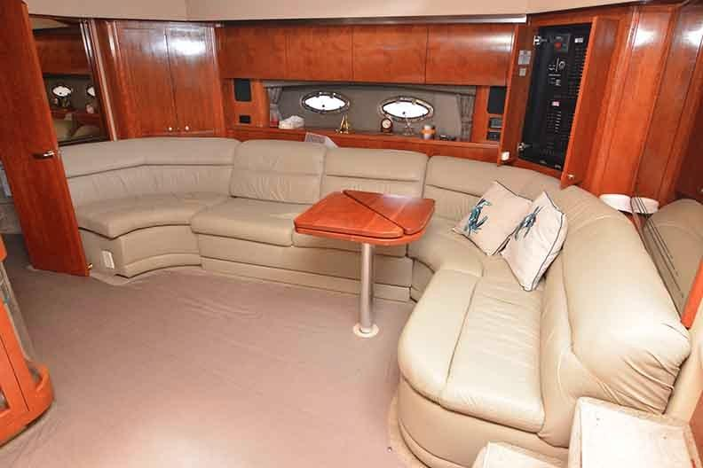Cruisers Yachts 500 Express - Salon seatign with flip over Cherrywood table
